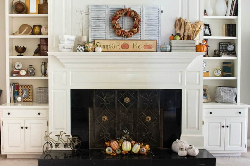 How to easily make drawer knob pumpkins with old drawer knobs, fleece, and fiberfill or old stuffed pumpkins. Easy and inexpensive fall decor!