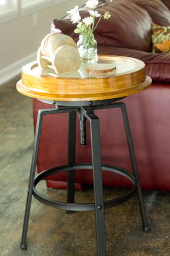 You can make a DIY Industrial Clock Table with a Thrift Store Clock and a Bar Stool