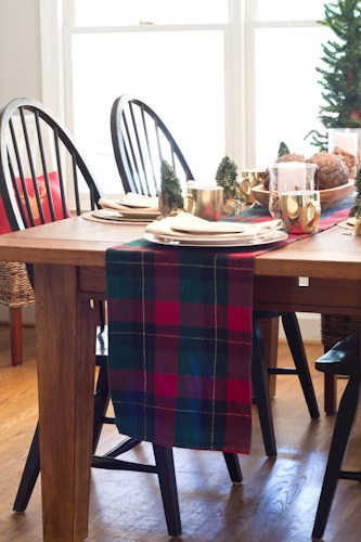 This is a quick and inexpensive way to dress up a table runner with fringe and glue.