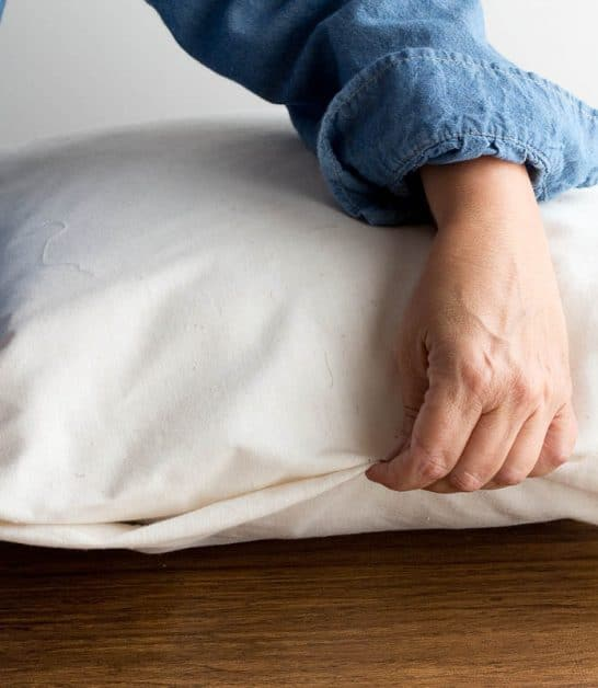 This is an easy way to make a no-sew pillow with fabric glue.