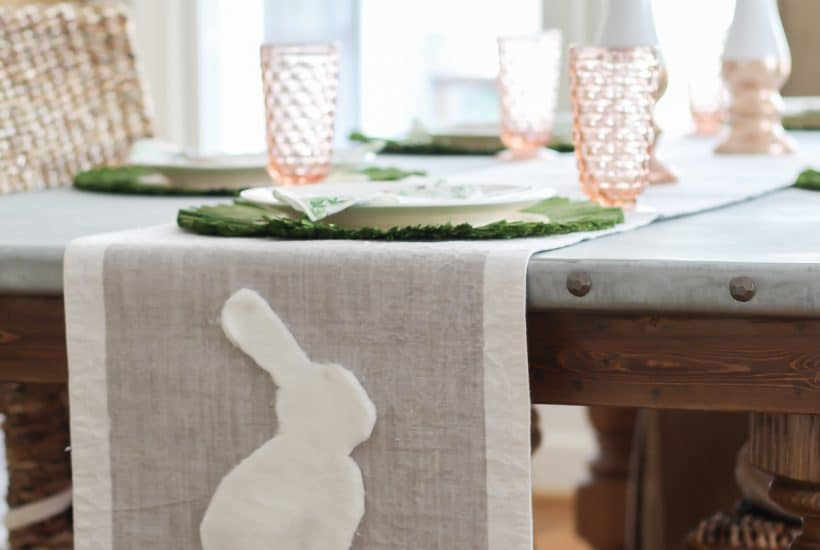 You can make this easy DIY Bunny Table Runner with a dollar store car cleaning cloth and a piece of fabric or an old table runner.