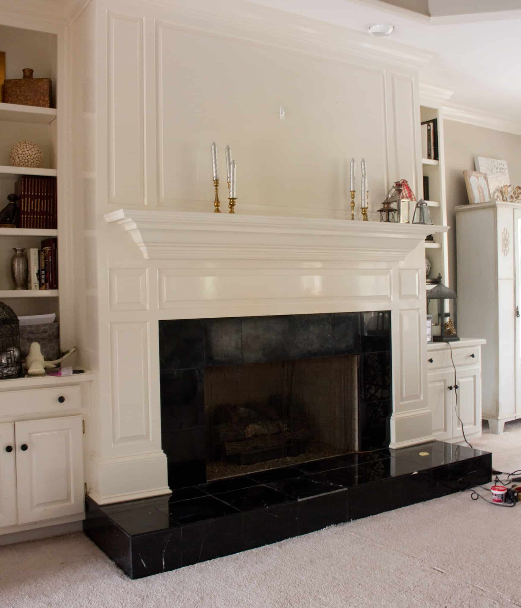 Faux marble fireplace savvy apron i painted our damaged black tiles on our fireplace to look like marble it solutioingenieria Choice Image
