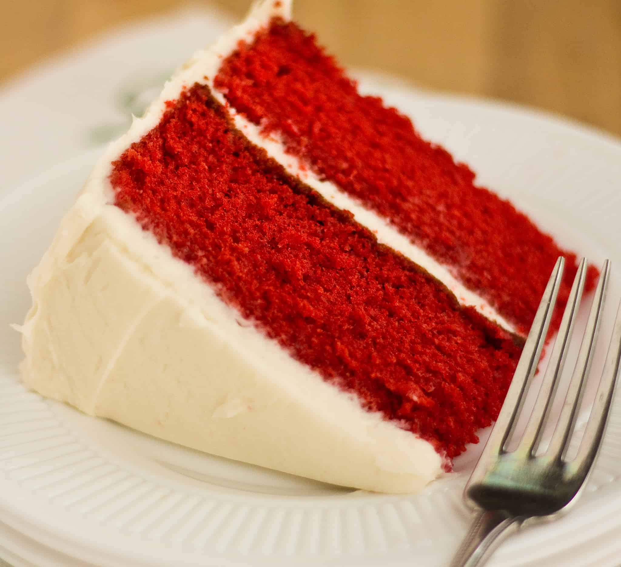 Most red velvet cakes are dense, but this recipe will give you the moistest red velvet cake that you have ever had. Plus it starts with a cake mix!