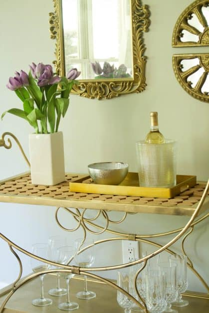 I wanted to makeover a bar cart, and I knew that it would be a multipurpose bar cart. I spray painted a thrifted bar cart, and I use for a hot chocolate bar, coffee bar, drinks and also as decor in my home.