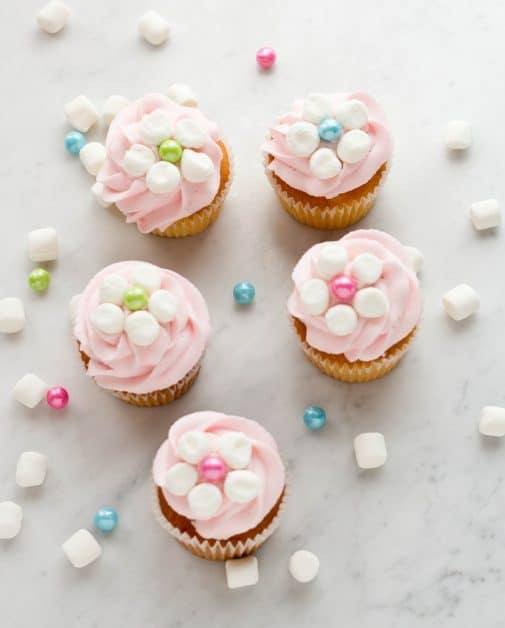 You can make these marshmallow flower cupcakes with your favorite recipe, or you can add the marshmallow flowers to store bought cupcakes. They are quick and easy to make.