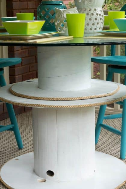 I found a couple of wire spools so I stacked two together, painted, and added rope trim for the base of my wire spool bar table. I added a glass top that I had, and my wire spool bar table looks beautiful!