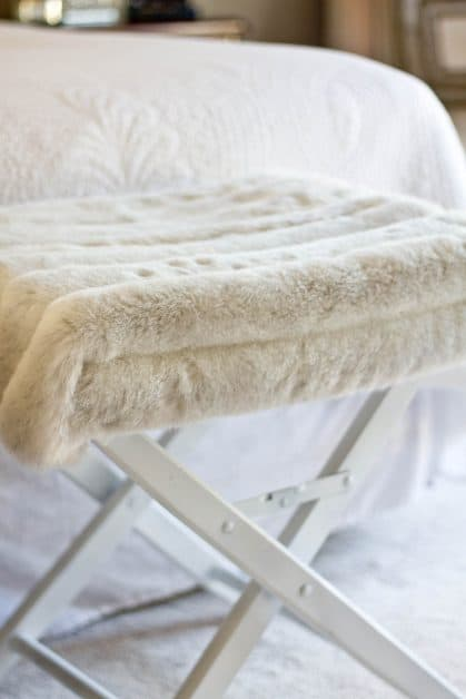 I made this x-leg bench for $7 using a thrifted director's chair and a thrifted faux fur coat. It is easy and so much cheaper than purchasing brand new benches.