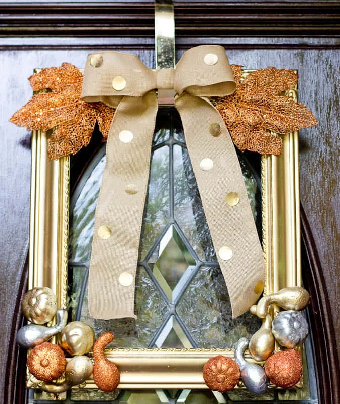 This metallic fall wreath was made with dollar store pumpkins and an old picture frame. I spray painted the little pumpkins and the frame with metallic spray paint, and glued it with a glue gun.