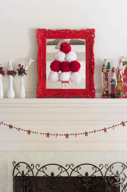 This Pom Pom Christmas Tree is made with an old mirror and pom poms made with yarn.