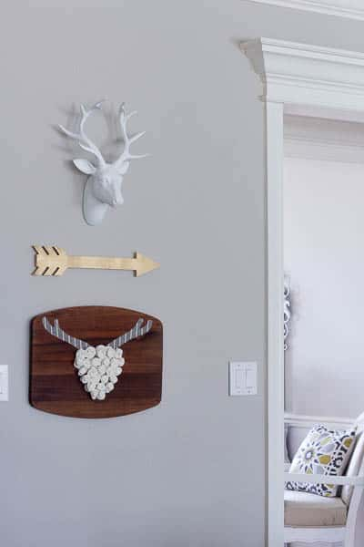 I made this easy deer head wall art with felt roses from items that I found at a thrift store.