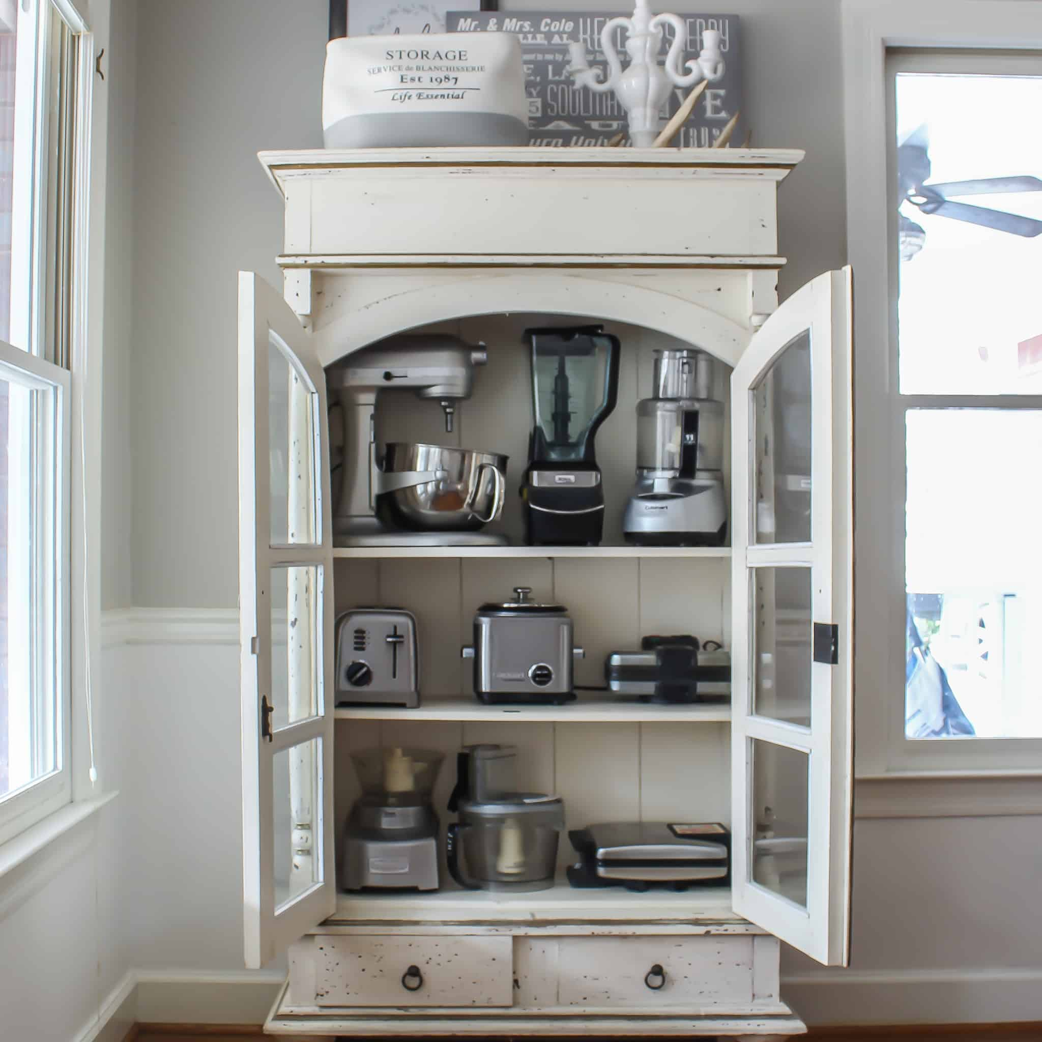 A cabinet to store small kitchen appliances.