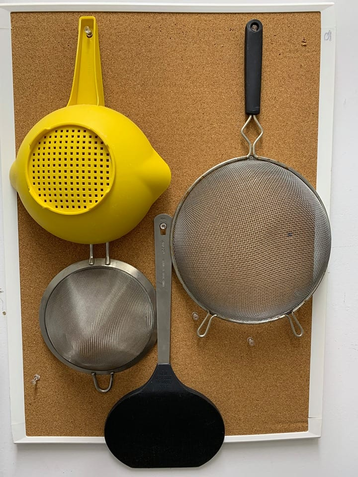 Use cork boards for hanging kitchen items.