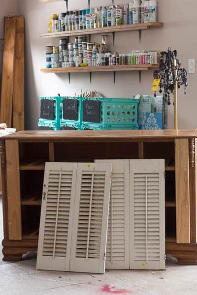 I make this beautiful dresser with shutters from an old dresser and a pair of thrifted shutter doors.
