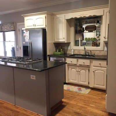 Our DIY Kitchen Remodel. We took our 90's kitchen with oak cabinets and updated it and now it is white, bright, and beautiful.