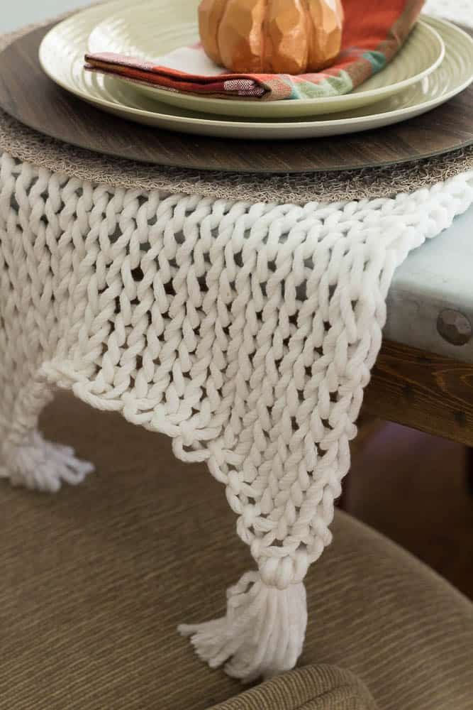This knitted table runner is knitted with bulky yarn and large knitting needles.