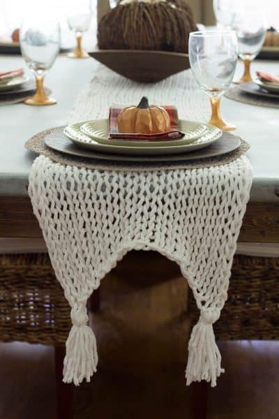 This knitted table runner is made with bulky yarn and large knitting needles and is super easy to knit.