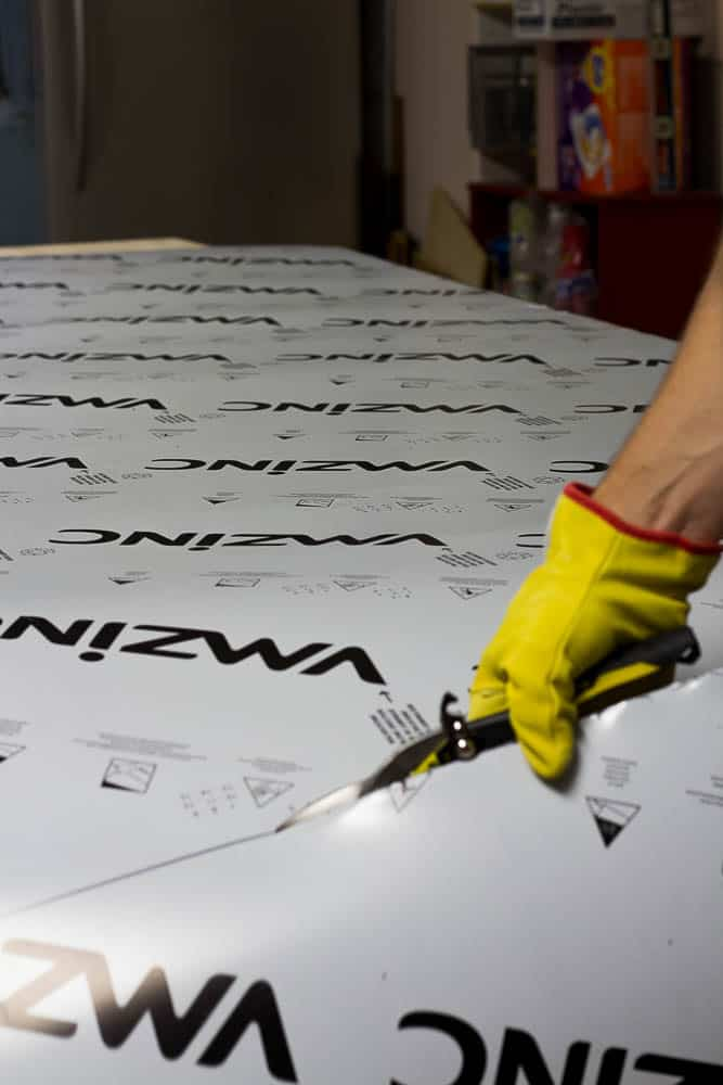 Applying the zinc to our DIY zinc top table tutorial.