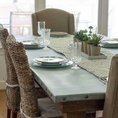 We built our DIY zinc top table using pine boards, farmhouse legs, and zinc.