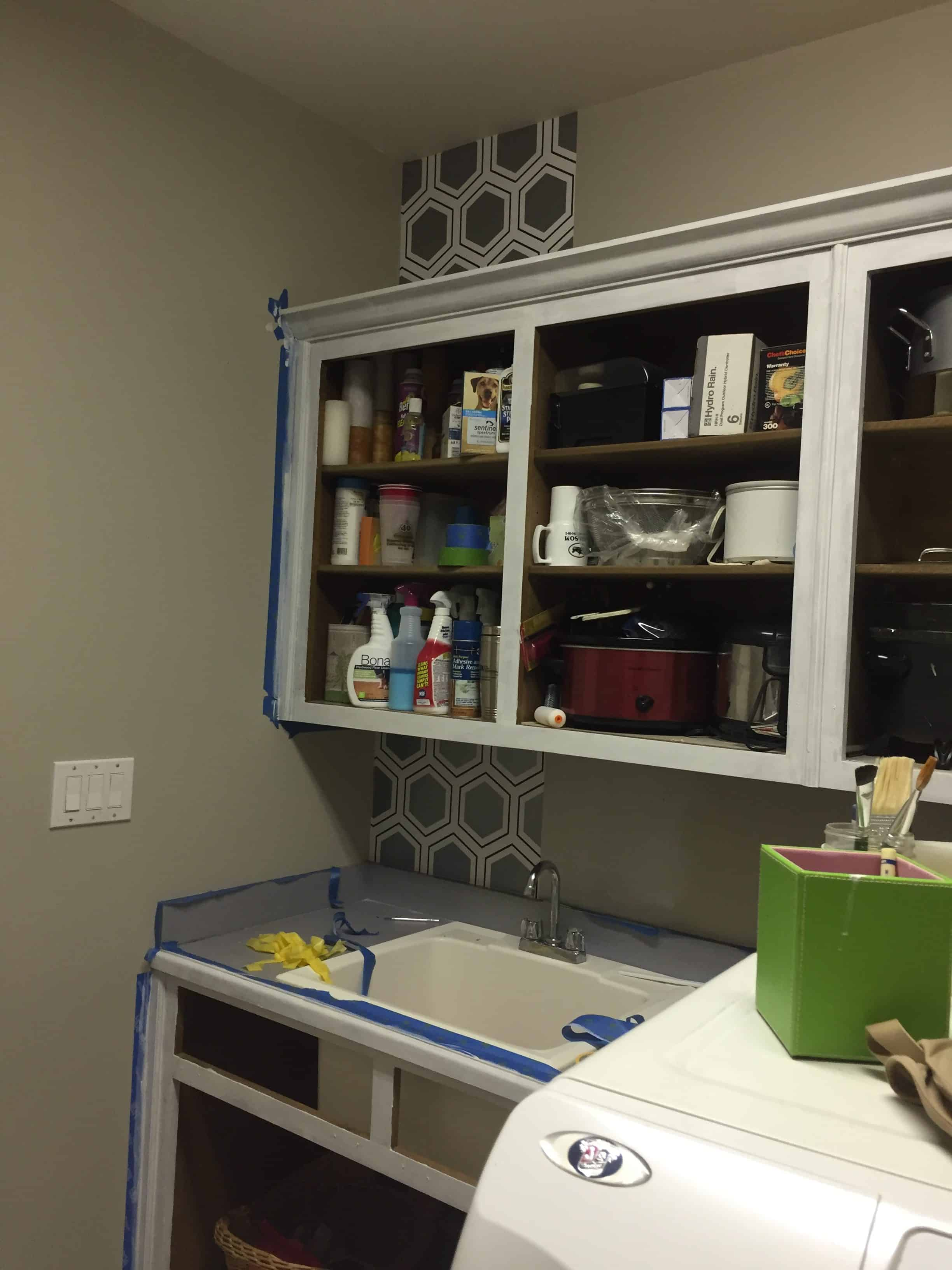 Cabinets in laundry room being painted.
