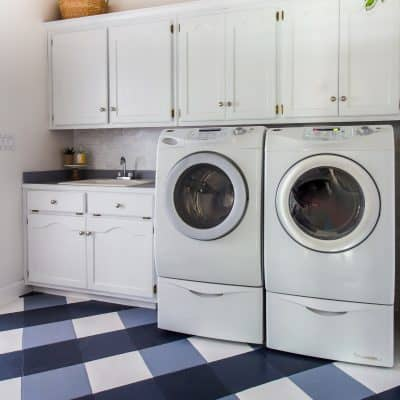 Laundry room makeover for the $100 Room Challenge with buffalo check painted floors.