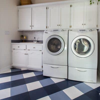 Laundry room makeover for the $100 Room Challenge with navy buffalo check painted floors.