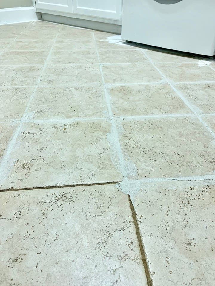 I filled the grout in with a filler before I started painting the buffalo check floor.