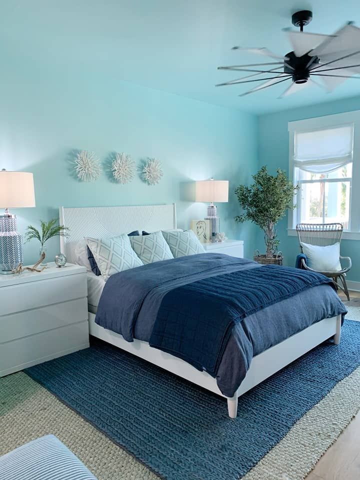 bedroom with blue walls.