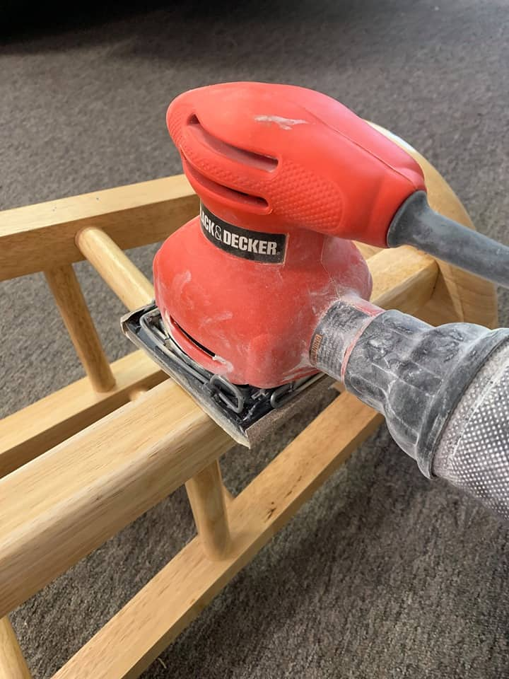 Use a belt sander to sand the diy small wooden stool.