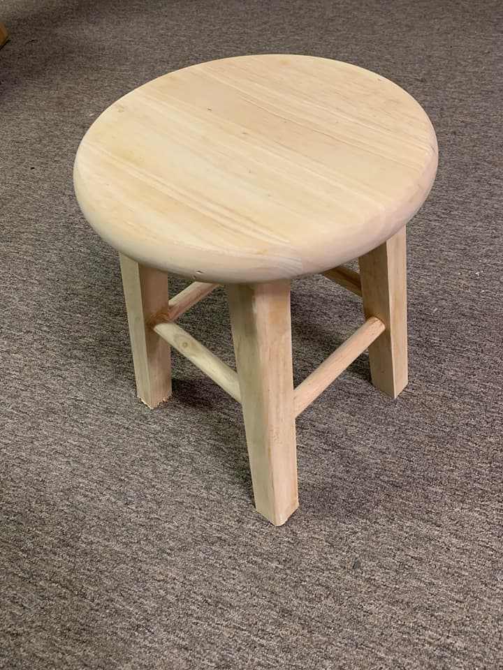 Cut the legs off the bar stool and sand the stool.