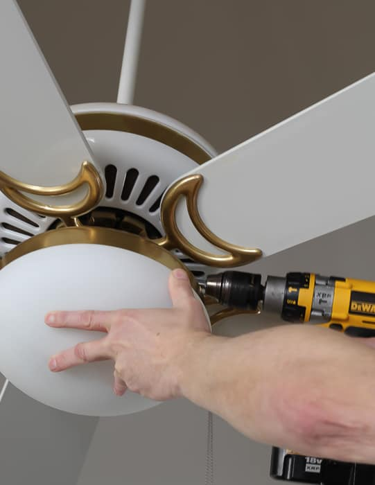 Paint your old ceiling fan without taking the fan down.
