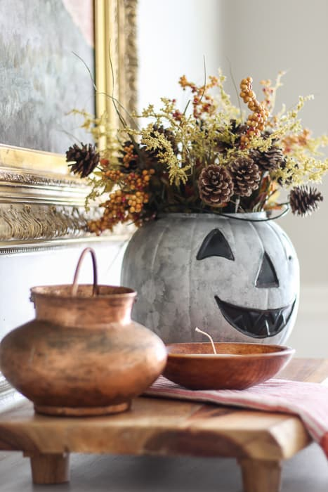 Add fall flowers to the galvanized pumpkin