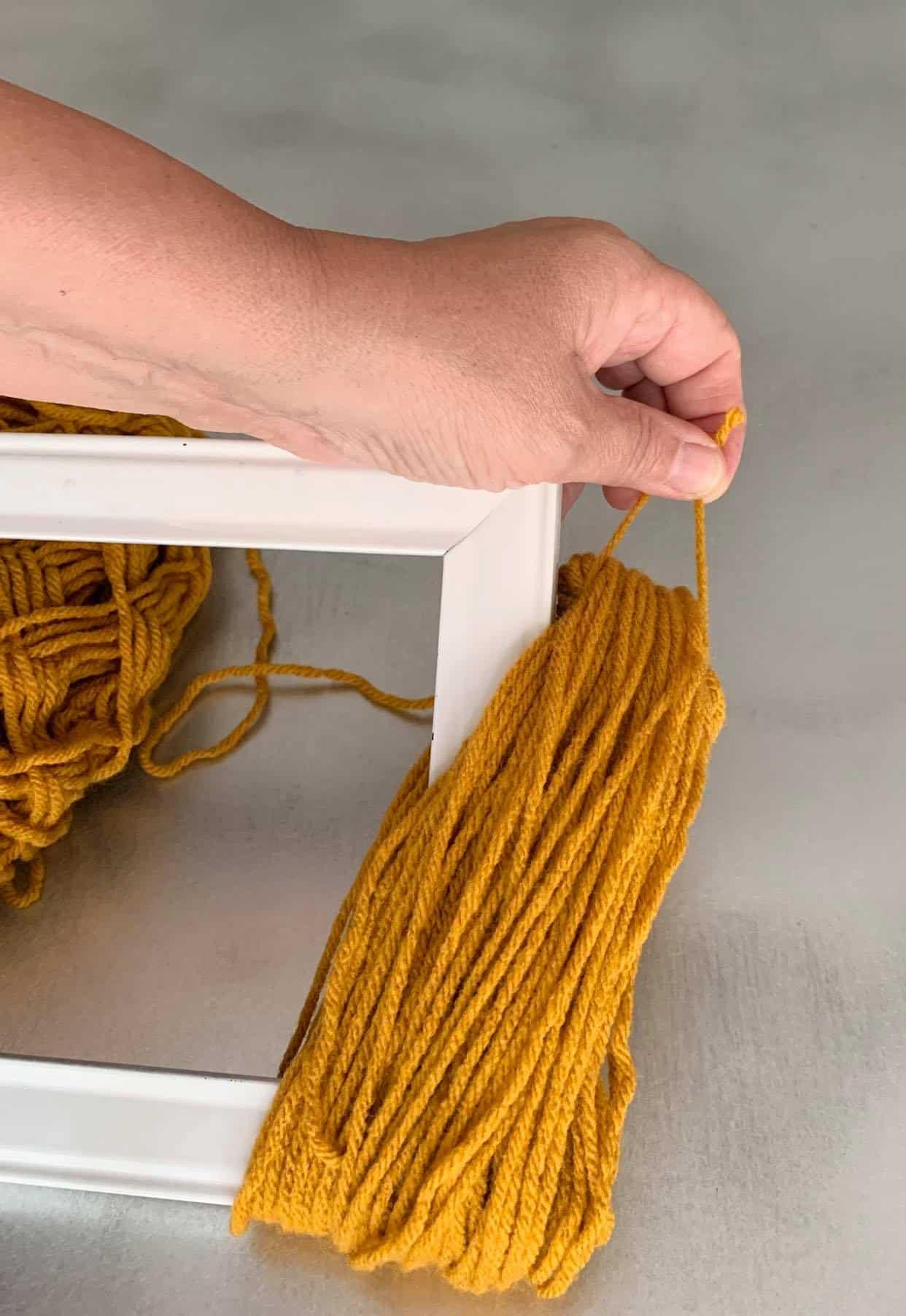 Slide the yarn off.