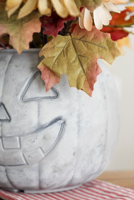 Paint the faux concrete pumpkin.