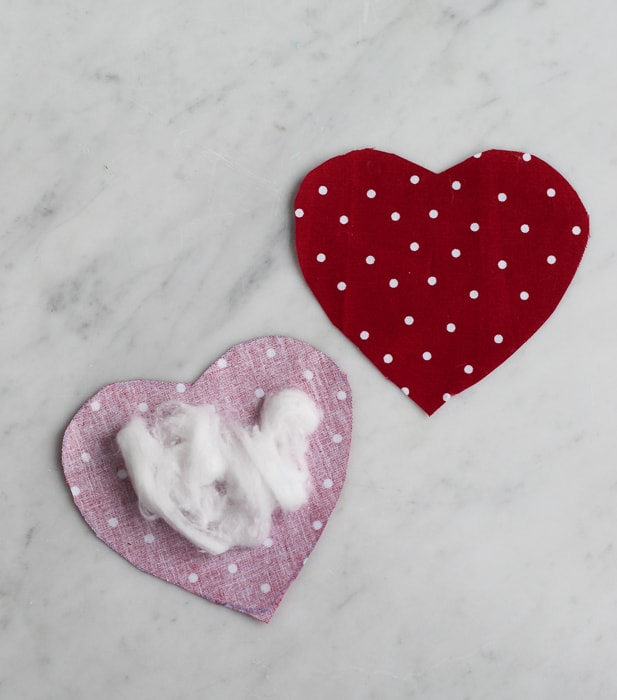 cut out two hearts from the material