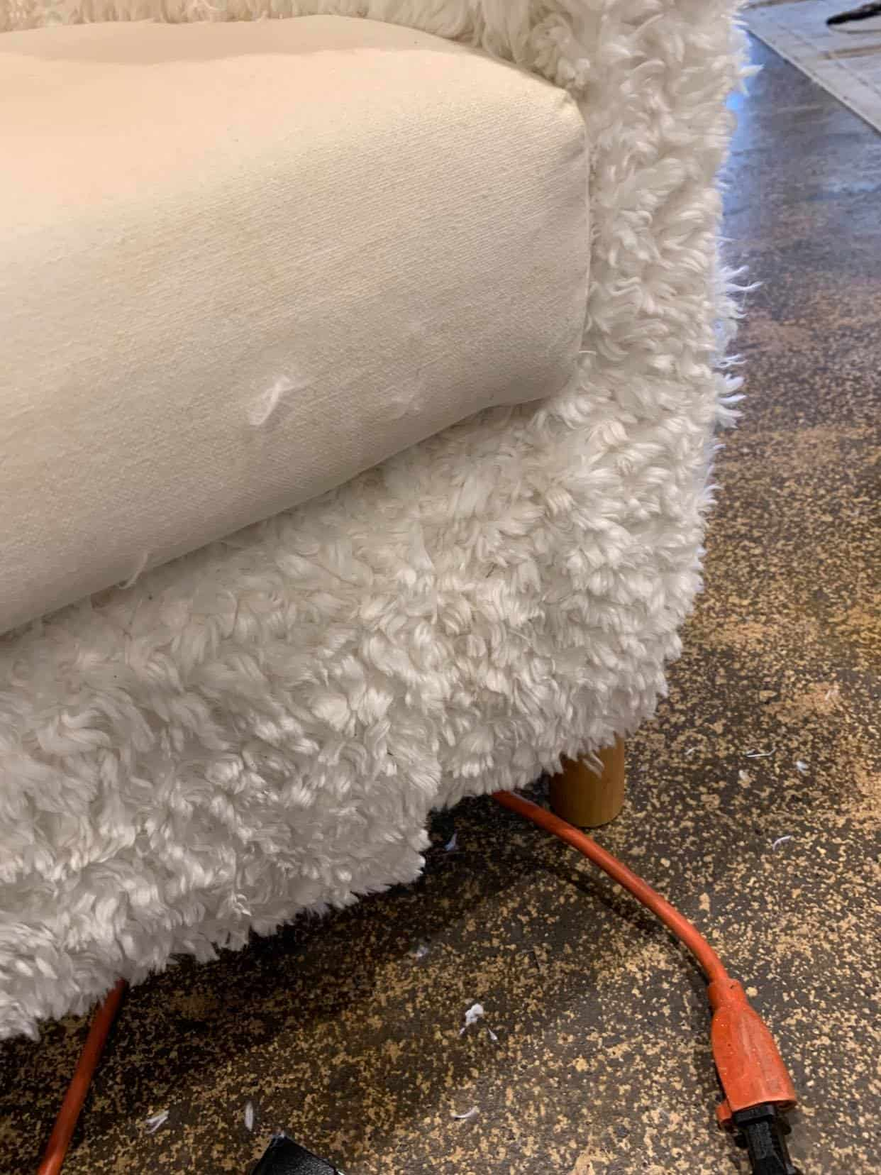 staple fur to the bottom of the chair.