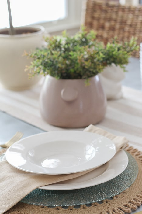 white plates on a spring table