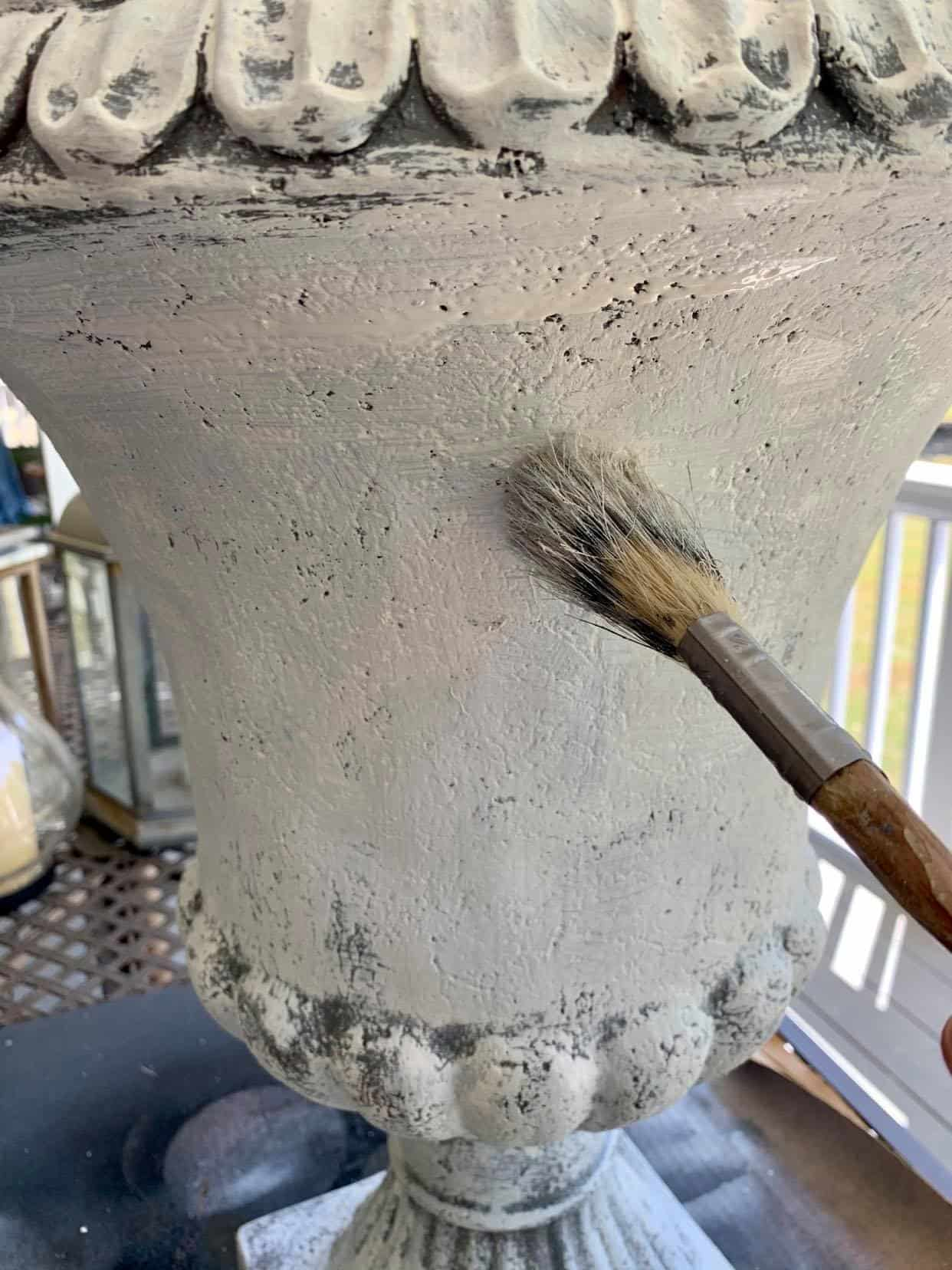 How to make a plastic urn look like aged concrete.