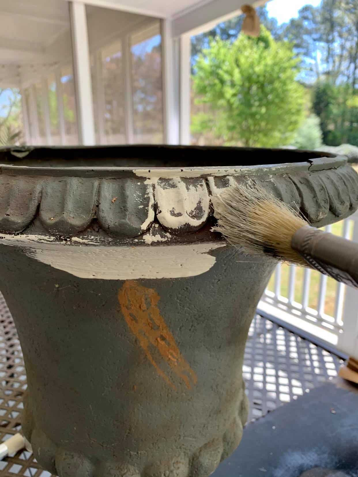 Paint the urn with white or cream paint